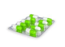Groene capsules in het pakket royalty-vrije stock afbeeldingen