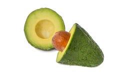 Groene die avocado in de helft met een been wordt gesneden Royalty-vrije Stock Foto's