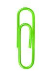 Groene die paperclip op witte achtergrond wordt geïsoleerd Royalty-vrije Stock Afbeelding