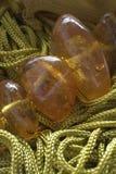 Groene draden en amber Royalty-vrije Stock Afbeelding