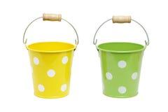 Groene en gele emmer Stock Afbeeldingen