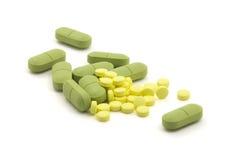 Groene en gele pillen Royalty-vrije Stock Afbeeldingen