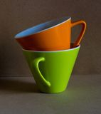 Groene en oranje kop Royalty-vrije Stock Foto's