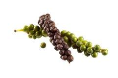 Groene en zwarte peperbollen stock fotografie