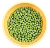 Groene erwten in een geïsoleerde kom Royalty-vrije Stock Afbeelding