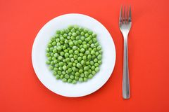 Groene erwten in plaat Stock Foto
