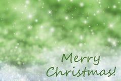 Groene Fonkelende Achtergrond, Sneeuw, Tekst Vrolijke Kerstmis Royalty-vrije Stock Afbeeldingen