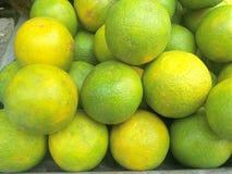 Groene gekleurde sinaasappel Stock Afbeelding