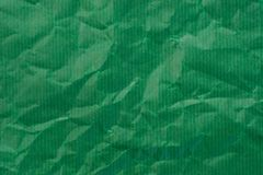 Groene gevouwen document textuur als achtergrond royalty-vrije stock foto