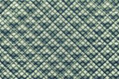 Groene gewatteerde stof met een patroon van kruisen Stock Foto's