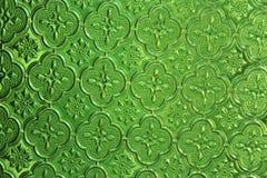Groene glasachtergrond Oud uitstekend glas met een abstracte flora Stock Foto