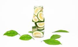 Groene kalkplakken in een fles Stock Fotografie