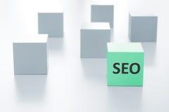 Groene kubus met SEO-teken Stock Foto