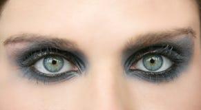 Groene ogenvrouw, zwarte make-upoogschaduw Royalty-vrije Stock Afbeelding