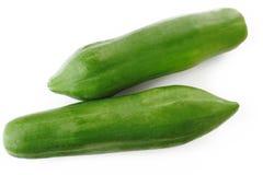 Groene papaja op wit Stock Afbeeldingen