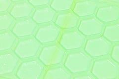 Groene plastic patroonachtergrond Royalty-vrije Stock Afbeeldingen