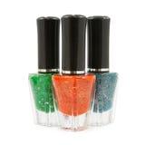 Groene rode blauwe nagellakfles Stock Fotografie