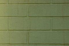 Groene textuur van een fragment van metselwerk op de muur van het huis Stock Foto