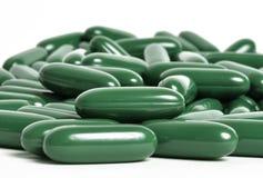 Groene theesupplementen Stock Afbeelding