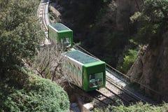 Groene trein in Montserrat berg royalty-vrije stock afbeelding