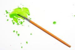 Groene verf en borstel Stock Foto