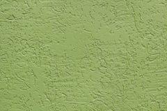 Groene vlakke ruwe geschilderde muur met vele holten gebruikt als achtergrond royalty-vrije stock afbeelding