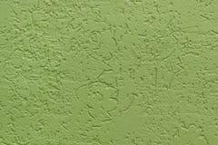 Groene vlakke ruwe geschilderde muur met vele holten Naadloze textuur gebruikt als achtergrond royalty-vrije stock fotografie