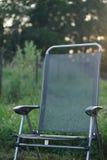 Groene vouwende stoel Stock Foto