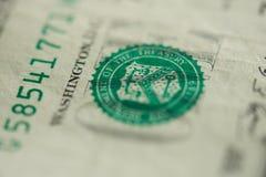 Groene zegel op één dollar stock fotografie