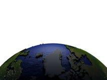 Groenland bij nacht op model van Aarde met in reliëf gemaakt land Royalty-vrije Stock Fotografie