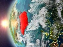 Groenland tijdens zonsondergang van ruimte Royalty-vrije Stock Afbeeldingen