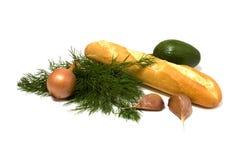 Groente en brood dat op wit wordt geïsoleerd. Stock Foto's