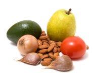 Groente, noten en fruit dat op wit wordt geïsoleerdi Stock Foto's