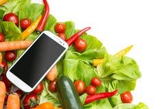 Groenten en Smartphone Stock Afbeelding