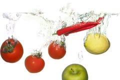 Groenten in water stock afbeelding