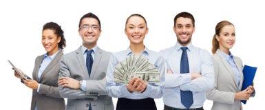 Groep bedrijfsmensen met het geld van het dollarcontante geld stock foto