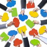 Groep de Toespraakbellen van de Handenholding Stock Foto