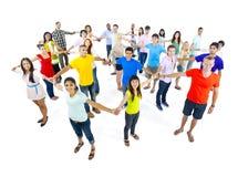 Groep die Mensen zich verenigen Stock Afbeeldingen