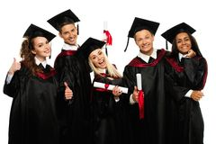 Groep gediplomeerde jonge studenten stock afbeeldingen