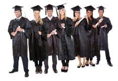 Groep gediplomeerde studenten stock fotografie