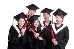 Groep gelukkige gediplomeerdenstudent Stock Foto's