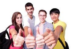 Groep gelukkige studentenduim omhoog Stock Foto's