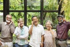 Groep Hogere Pensionering die Digitaal Levensstijlconcept hanteren royalty-vrije stock foto
