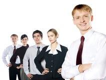 Groep jonge bedrijfsmensen die op wit worden geïsoleerde Stock Afbeelding