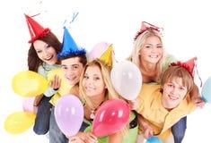 Groep jonge mensen in partijhoed. Stock Afbeeldingen