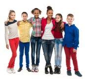 Groep kinderen met verschillende teint stock fotografie