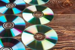 Groep kleurrijke compact-discs en exemplaarruimte stock foto