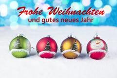 Groep kleurrijke Kerstmisballen met tekst in het Duits Royalty-vrije Stock Afbeelding