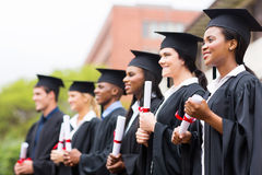 Groep mensen met universitaire diploma's stock foto's