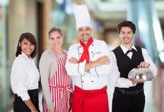 Groep restaurantpersoneel stock afbeeldingen